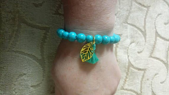 Check out this item in my Etsy shop https://www.etsy.com/uk/listing/530556330/turquoise-tassel-boho-bracelet-with-gold