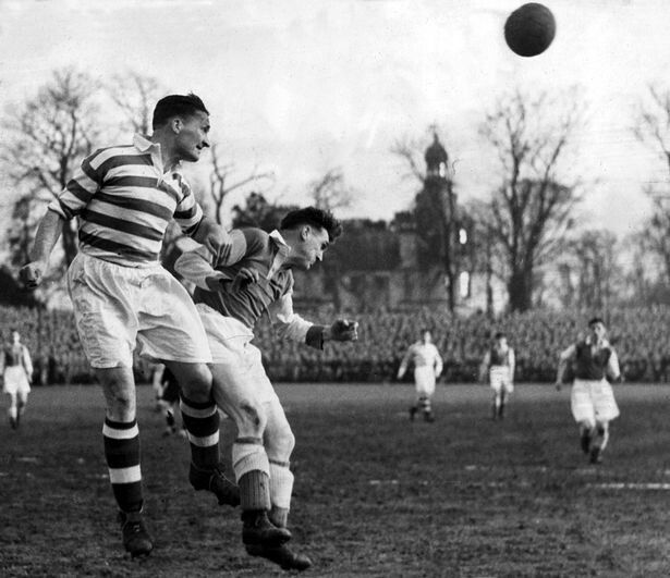 Jock Stein heading the ball upfield. (1955)Picture: Daily Record.