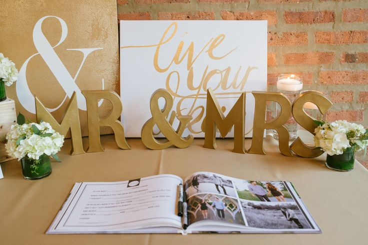 Sign in table at wedding reception. Guest book. Custom signage. Gold wedding ideas.   Venue: Loft on Lake | Photography: Thara Photo | Planning: Elisa, The Simply Elegant Group | Draping: Art of Imagination | Floral:   Gratitude Heart Garden | Catering: FireFly | Cake: West Town Bakery | Bar: Binny's | Reception: Toast & JamTransportation: Windy City Limo