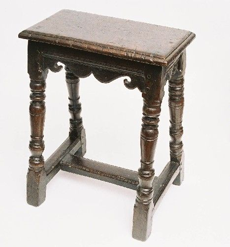 A wooden stool, of a kind described in the Tudor period as a 'Joint stool', because of the joinery involved. This example is from the 17th century and is in the Shakespeare Birthplace Trust collection.