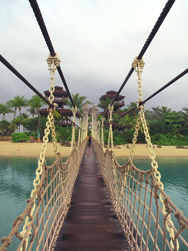 Suspended bridge to Sentosa Island, Singapore (by...