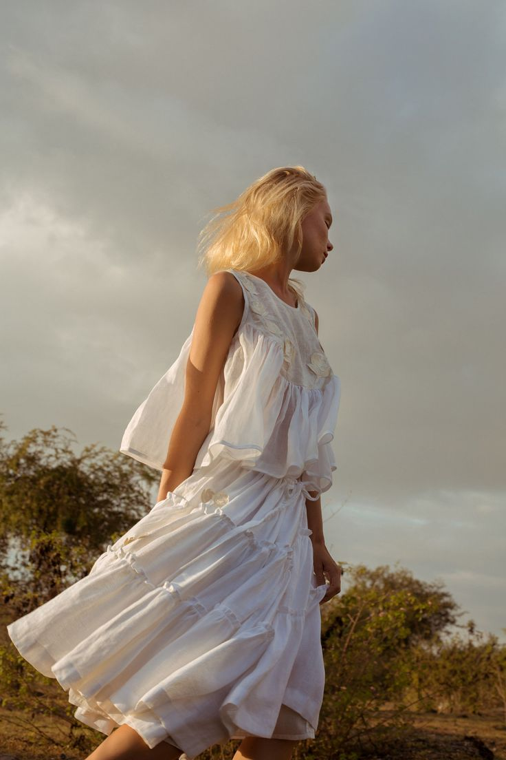Innika Choo Summer 2017. The Bali-based Australian designer's long awaited collection finally launched last week and as expected, it's perfect. Dreamy brocade anglaise blouses are smocked on the shoulders to be worn multiple ways, floor length maxis feature ruffled cap sleeves and prairie-inspired bibs, and hand printed linen tops are finished with Edwardian inspired collars and embroidered rose appliqués.