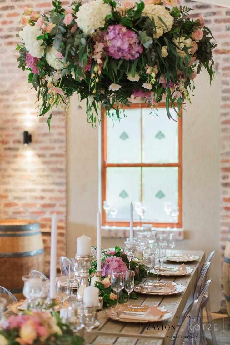 Garden styled wedding, garden style hanging flowers, garden wedding table, flower ceiling,  garden flower hanging, suspended arrangements, suspended flowers