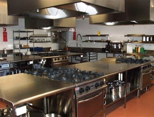 Comercial Kitchen Design interesting layout with island cooktops and separate hoods in
