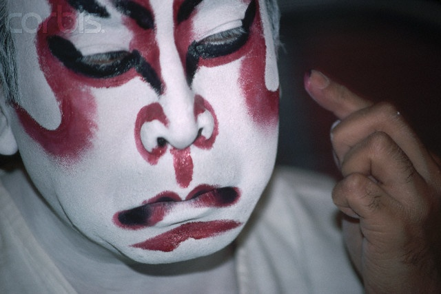 Kabuki actors do not wear masks like Noh performers. The make-up covers the face, neck and hands with white paint and have red painted around their eyes and their lips. The color expresses the emotion.