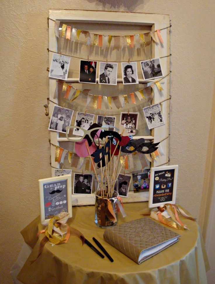 50th wedding anniversary party guest book picture garland on window frame