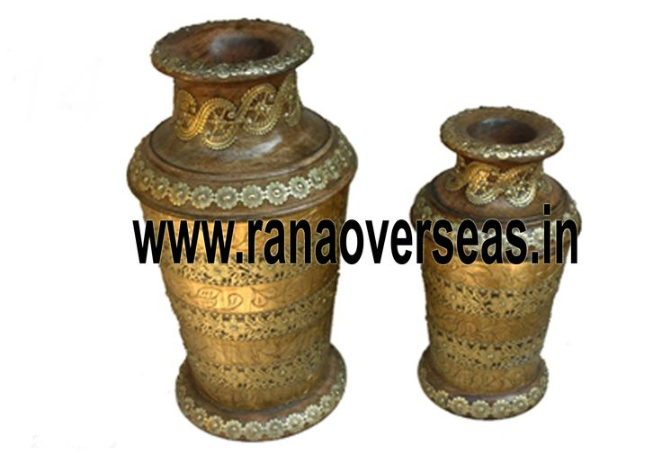 Wooden Flower vases are designed in styles ranging from exquisite to outrageous ones. These Flower vases chiseled out of variety of materials in varied shapes are extremely eye-catching with their compelling beauty. The Wooden flower pot base is made heavy to provide support to its body. Our flower pots have gained immense popularity worldwide.Various Sizes Are Available In These Wooden Flower Vases. Hand Work Is Also Done On Wooden Flower Pots, Wooden Vases.