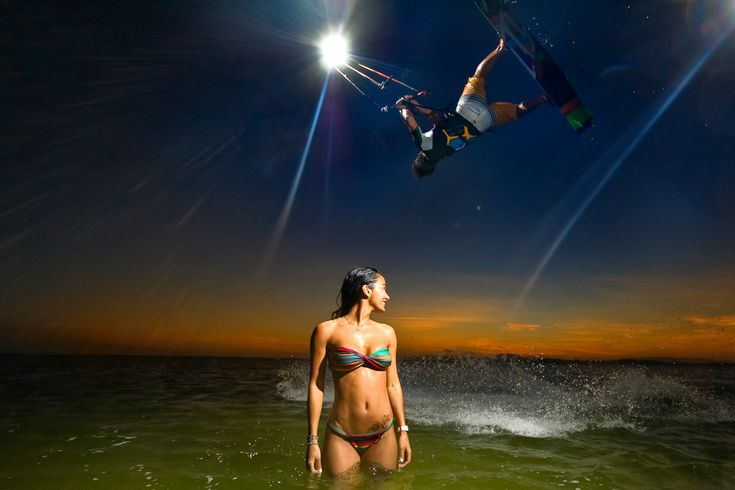 Handlepassing in the sunset on your little North kite -while-flying-over-beautiful-girl-in-bikini is how Reno Romeu spends his day at the office.
