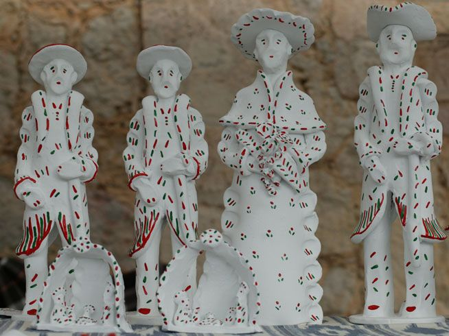 Siurells – Clay whistles. Balearic islands. Figures traditionally representing a peasant or the devil. The figure is placed on a base with a whistle. It is then whitewashed and painted in green and red strokes.
