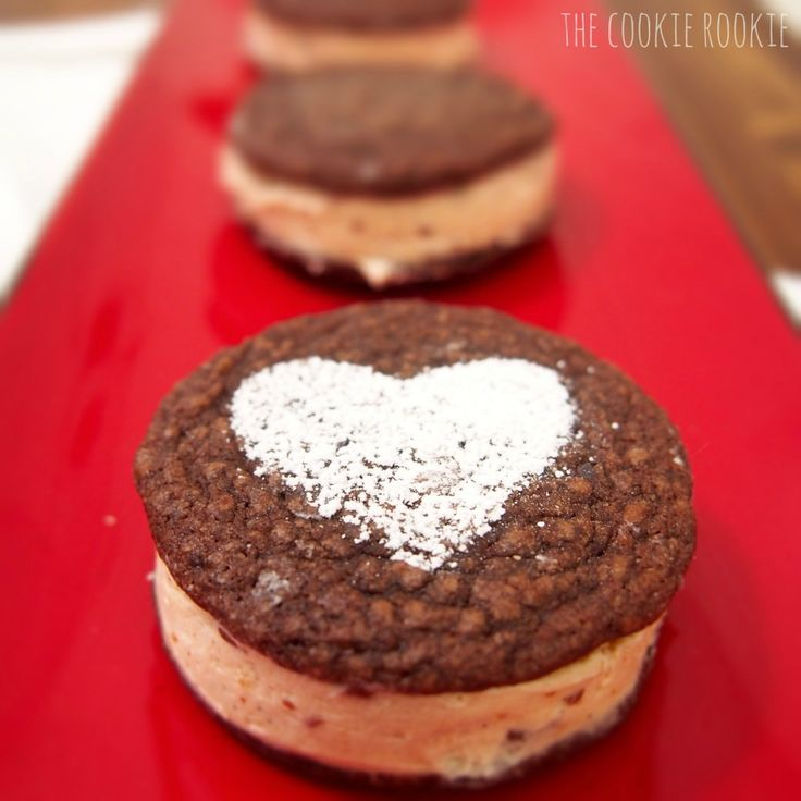 brownie whoopie pies made with reeses peanut butter cup filling.  AMAZING.   www.thecookierookie.com
