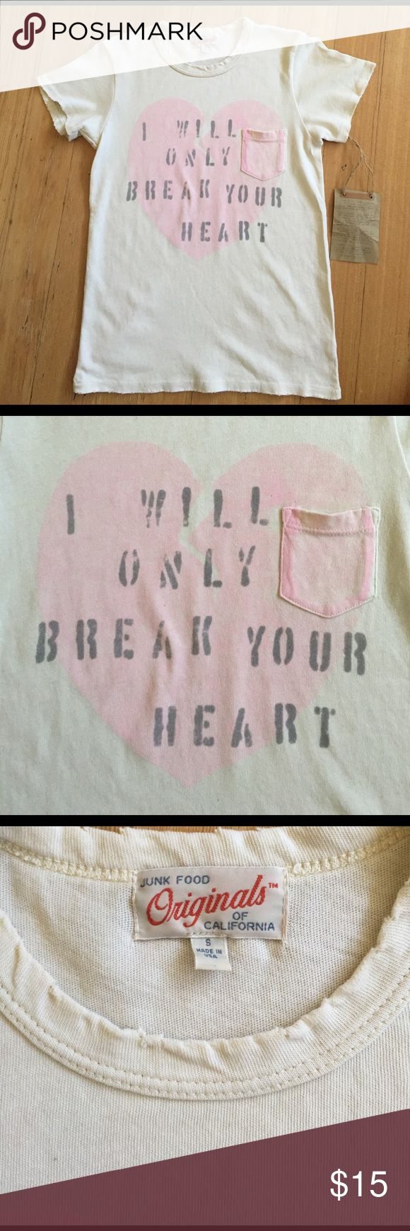 "Junk Food Break Your Heart Tee in Almond Junk Food tee says, ""I will only break your heart"" on an off white pocket tee.  Super soft with intentional distressing at the collar and hem.  Made in the USA. S measures 16"" wide, 22.5"" long, M is 17"" wide, 23"" long, L 18"" wide, 24"". Junk Food Clothing Tops Tees - Short Sleeve"