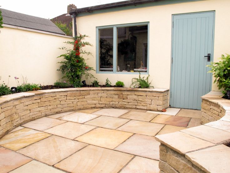 The sweeping form of the perimeter raised planting bed is a key design feature  and defines the space well
