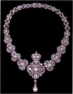 Queen Victoria's Golden Jubilee Necklace (presented to Queen Victoria in 1888) features a central quatrefoil diamond motif with a large pearl in the middle, topped by a crown and underlined with a drop pearl. The next four links in either direction are graduated trefoil motifs; the central piece and the six largest trefoils can also be worn as brooches. Queen Victoria was pleased with the final gift, so much so that she declared it to be an heirloom of the Crown.