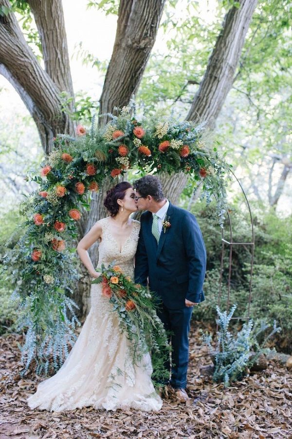 Bride and Groom Under Floral Arch