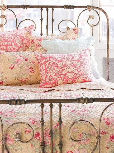 Old iron bed, pretty pink bedding.