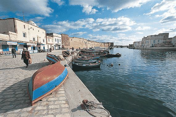 Bizerte, Tunisia.  Immerse yourself in the culture and visit the Souks for some great buys.  Beautiful beaches too.