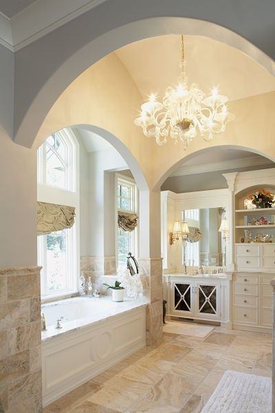 master bathroom with chandelier and wall openings