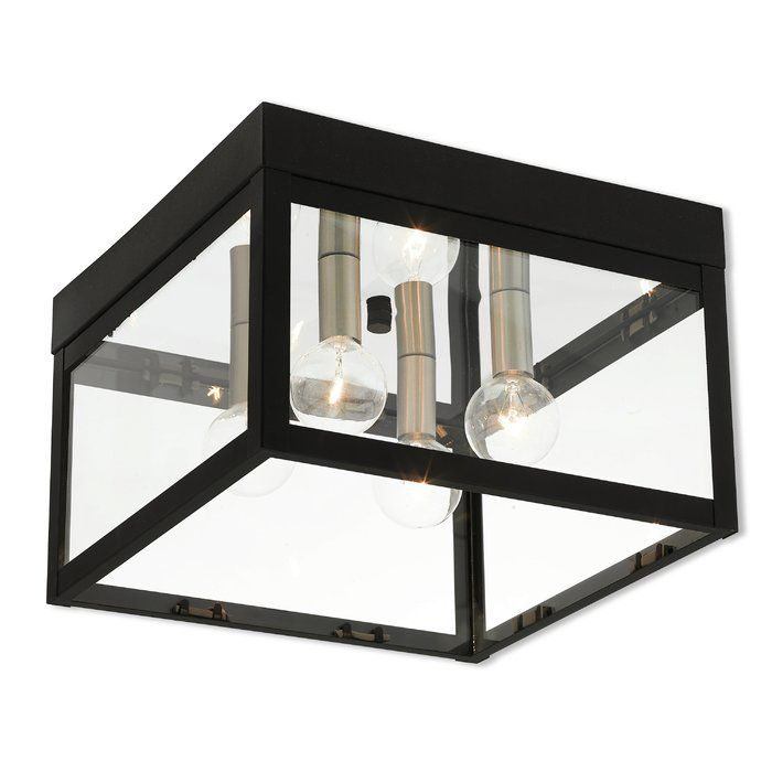 This collection features bold beautiful lines and a dramatically simple shape defines this outdoor flush mount which features panels of clear glass that seem to float between the solid brass hardware of the light.