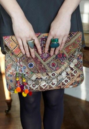 Vintage coin clutch designed by Antik Batik...I've never really like clutches but this is too awesome.