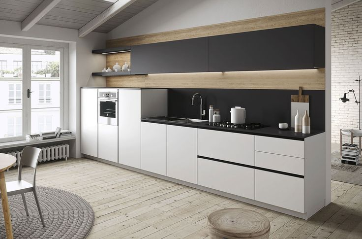 Modern kitchen First with doors in melamine iron grey soft and arctic white soft. #Worktop in laminate iron grey. Back panel and open units in melamine nature oak. cucine moderne #cucinelineari #linearkitchen #Snaidero