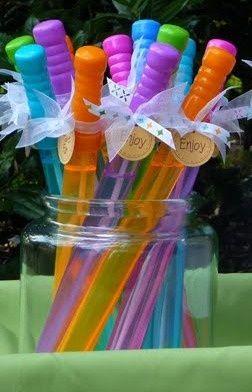 Tea Party Birthday Ideas! | Hot Mama's Blog / fairy wands for favor. Centerpiece flowers in tea tin.