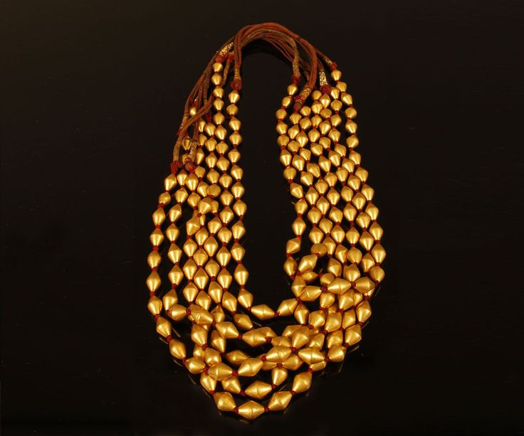 Gold Dowry Beads with wax core. India, Mid-20th century  22 karat gold with wax core on silk string