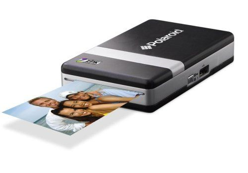 Polaroid CZA10011 PoGo Instant Mobile Printer Polaroid,Paper refills for this are a lot cheaper than a real Polaroid camera. Looks like you can hook your phone up to it too.