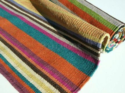 Dywan Feel green Linie Design. Płasko tkany dywan wełniany w kolorowe pasy.
