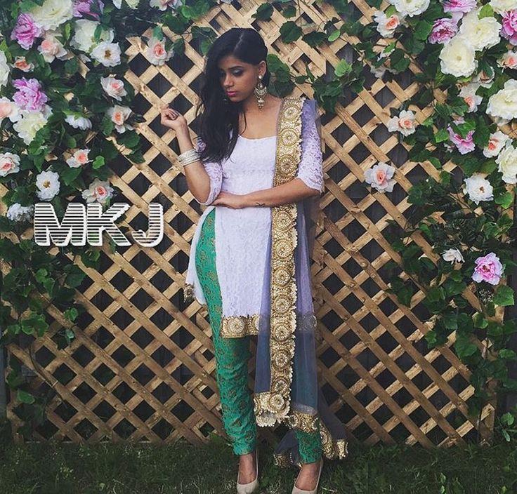 MKJ white lace punjabi suit with green pajami and net blue chunni