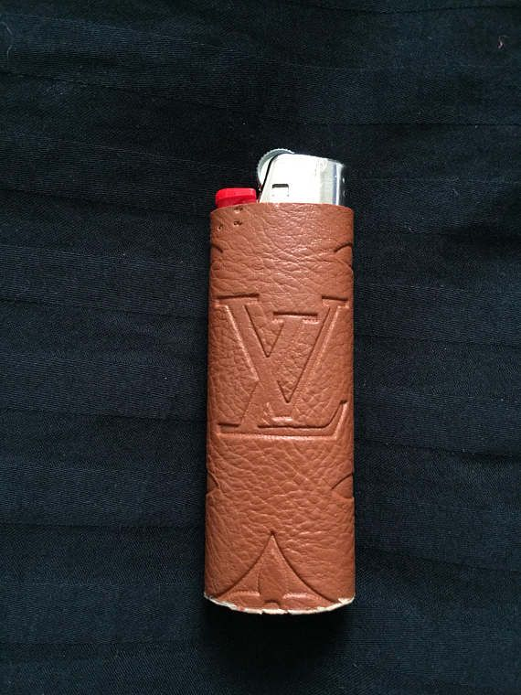 louis vuitton lighter. louis vuitton embossed lighter sleeve these are for the regular material is faux leather, durable