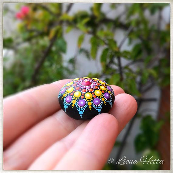 This is a baby charm stone Mandala, made with love and joy. It is here for you to fall in love with it and take it home or give as present to a loved person. It is approx. 2.7 cm. diameter and it is sealed with matt varnish. It is suitable for indoors use. Please handle with care and do