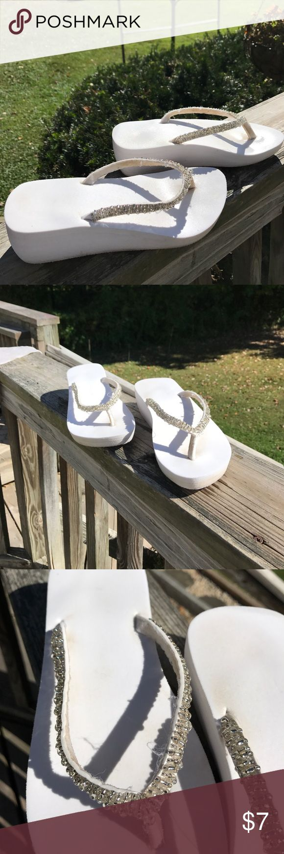 Ladies white wedge flip flops with sequins. Worn once for my wedding! They are in really good shape! There is no size but I am a 7 1/2. I think they are a 7 Shoes Wedges