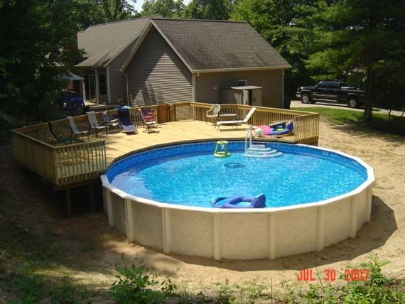 Round pool deck on the yard pool deck decorating ideas Above ground pool patio ideas
