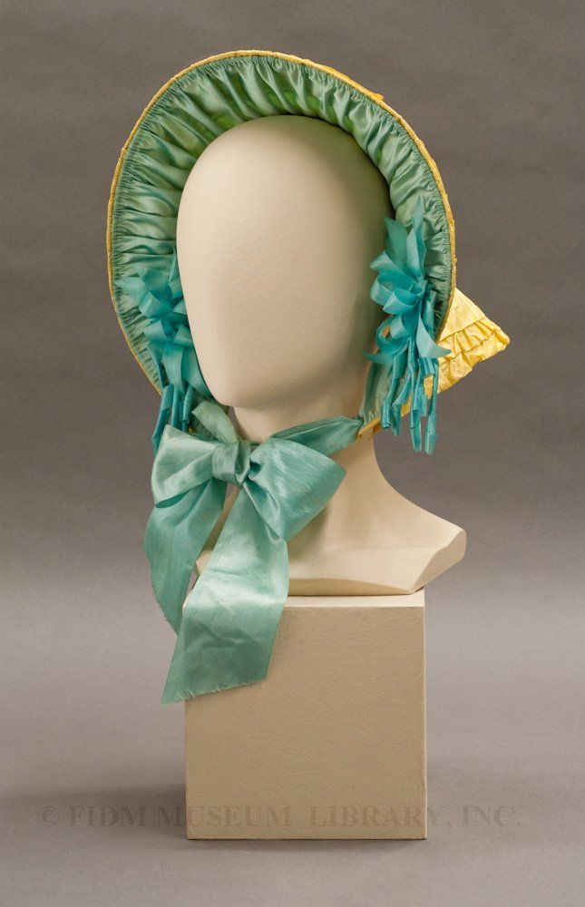 This colorful silk bonnet was purchased for an 11-year-old girl in 1852. Sadly, she died before she could wear it.