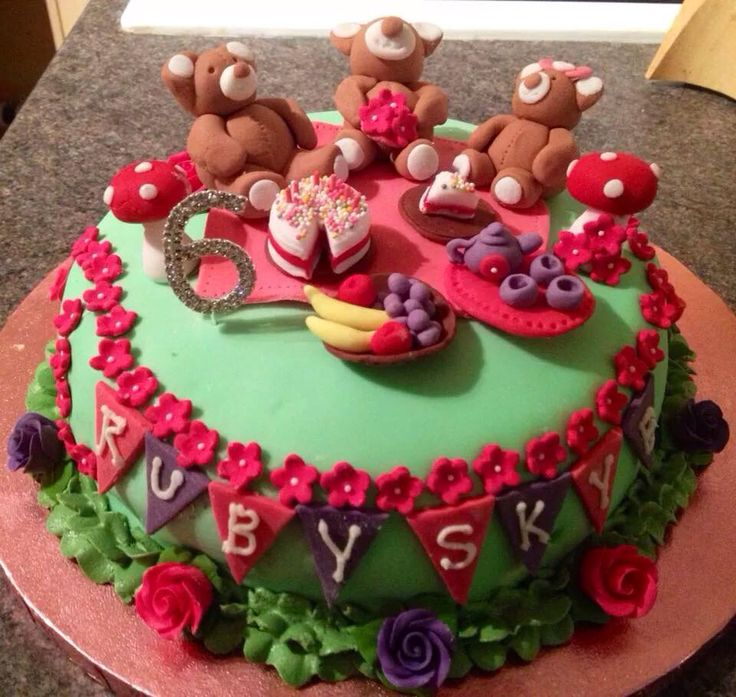 Teddy Bear Picnic Cake. Vanilla sponge filled with homemade strawberry jam and vanilla buttercream. Cake toppers all made from modelling paste and took around 8 hours!