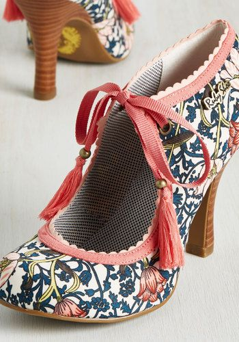 Vibrantly sketched vines in shades of navy, bright green, and blooming pink pop on the cream-colored background of this garden-party-perfect heel! Boasting coral and rose scalloped trim and a coordinating lace closure touting tassels, these stacked heels will see that your style is always in full bloom!