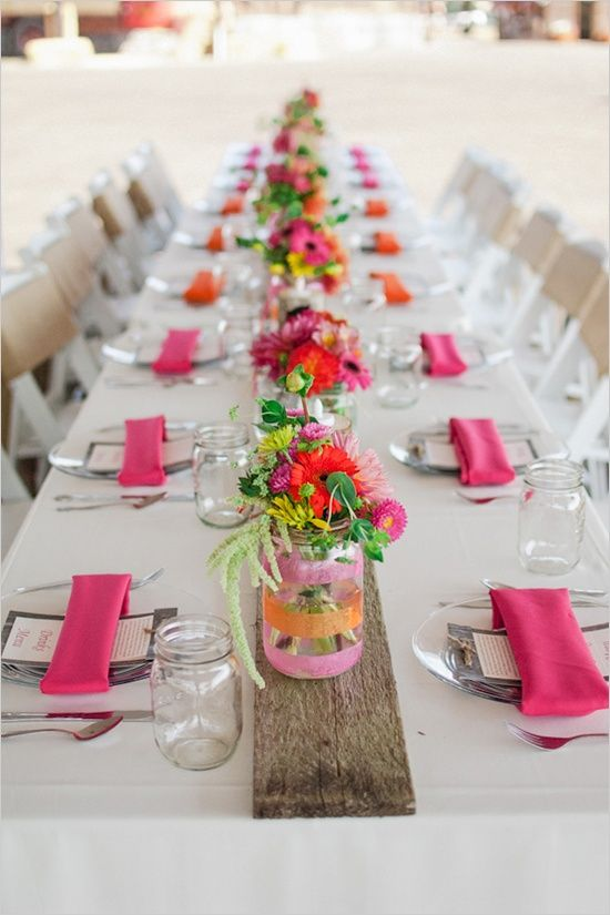 Mason jars with sheer ribbon to match your venue....so sweet...and so inexpensive!!