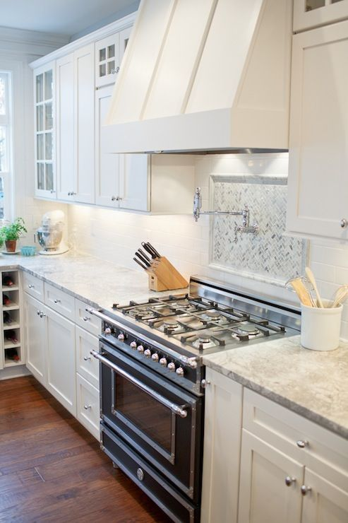 White kitchen with Vermont white granite, white shaker cabinets and Bertazzoni Heritage Collection Range. #kitchens #Bertazzoni #white #granite