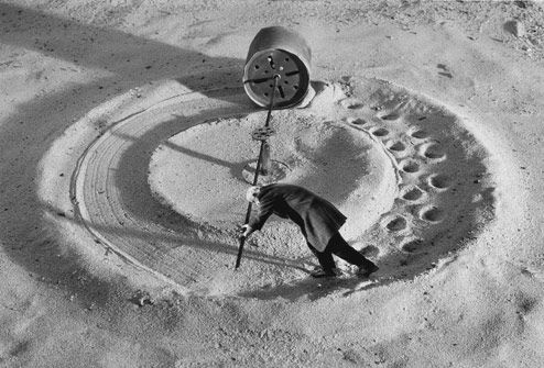 """If you need a photograph that represents life's futility…    …look no further than Gilbert Garcin'sLe moulin de l'oubli, or """"Mill of Oblivion""""…"""