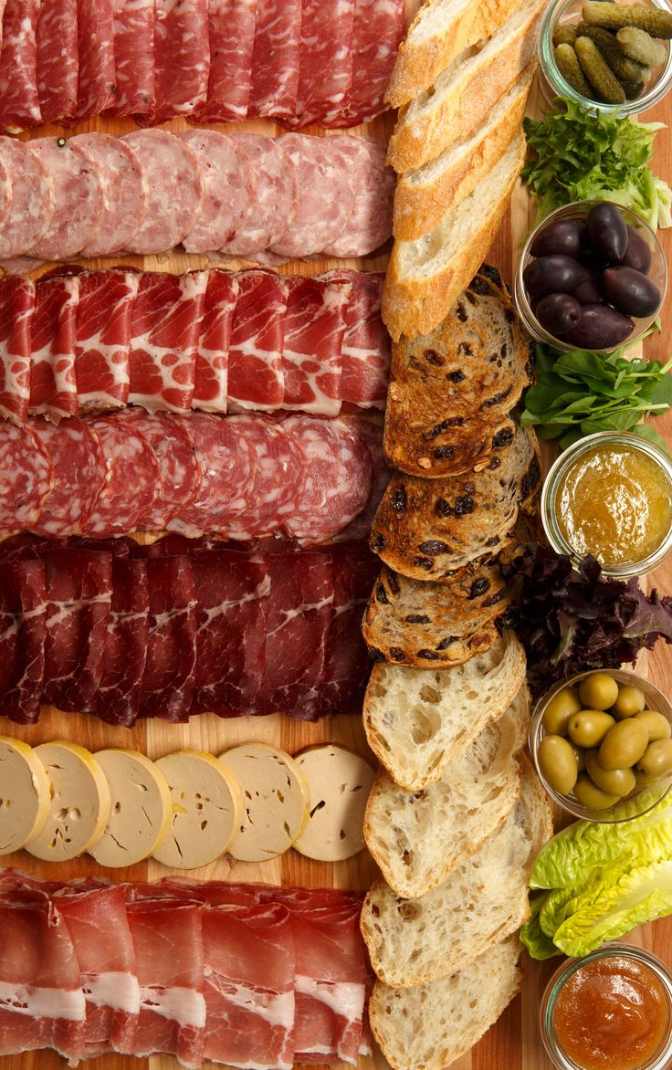 A variety of cured meats and pâtés accompanied by pickles, olives, and mostarda, round out our charcuterie board. #charcuterie #AUIFineFoods
