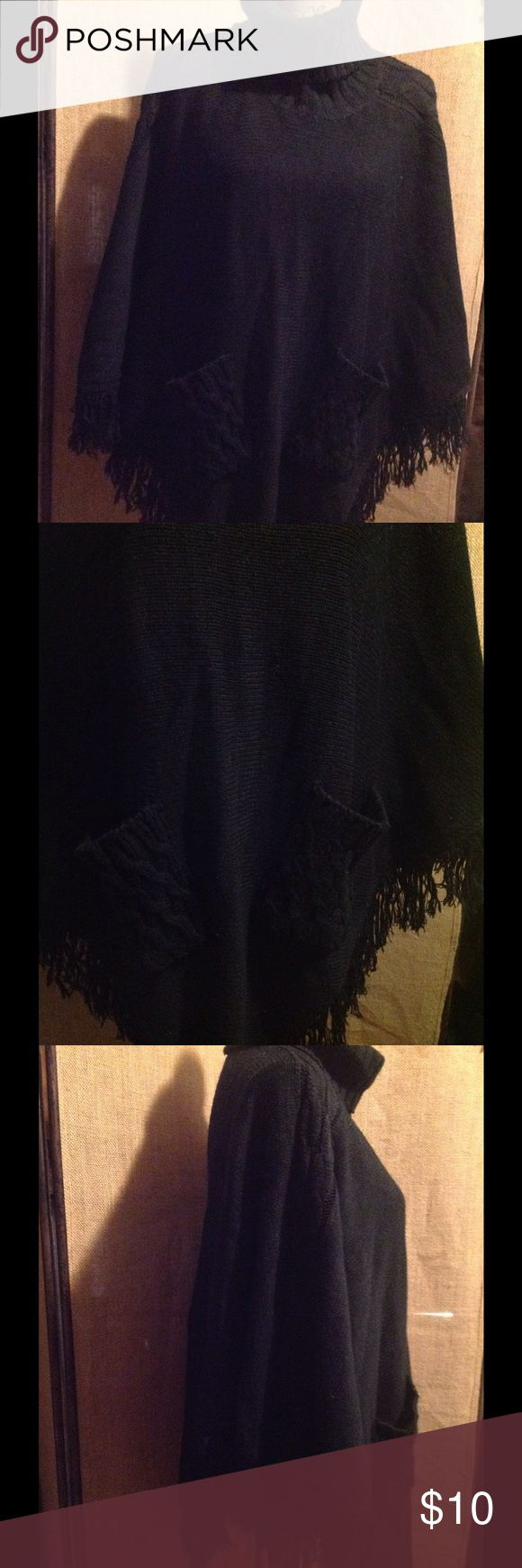 Jennifer Lauren shaw sweater Jennifer Lauren shaw sweater size XL. It is black. Fringed at bottom. Good condition Sweaters Shrugs & Ponchos