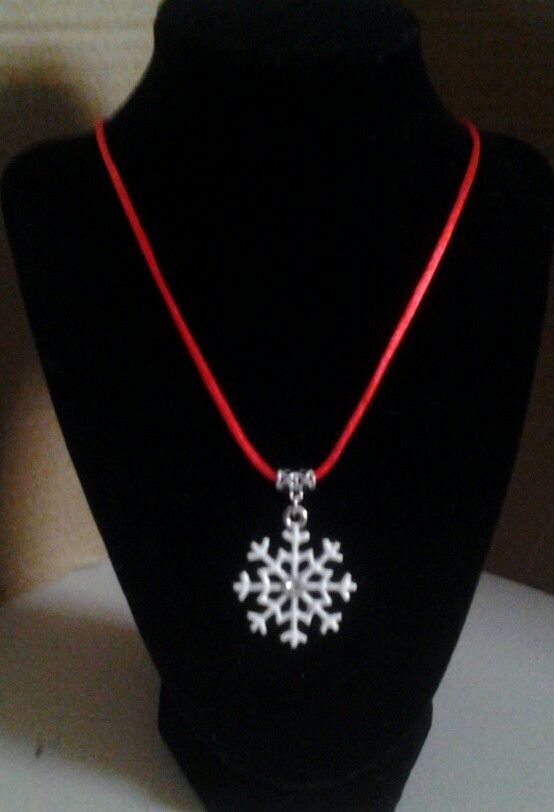 Large snowflake with  rhinestone in the center on a red cord