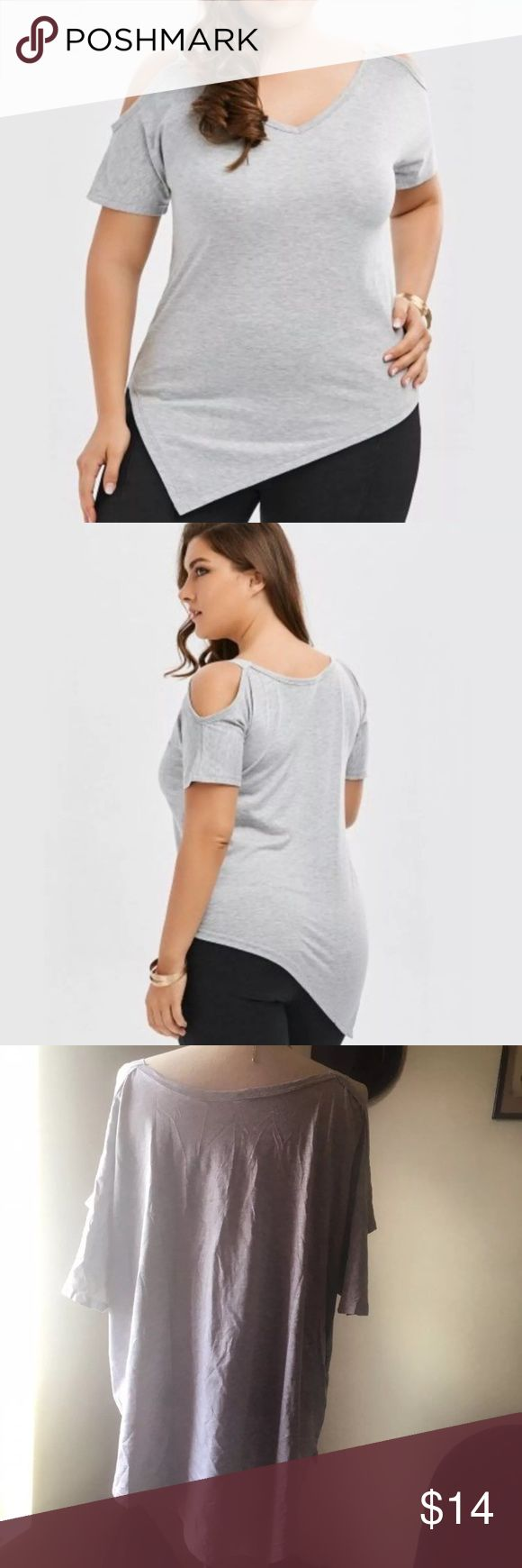 "Asymmetrical Grey Shirt BRAND NEW (ordered online, no tags) super cute cold shoulder tee with asymmetrical hem. Light grey with silver little straps on the shoulders. Chinese company measurement is 5x= size 22, 29.53"" long. Reasonable offers accepted. Tops"
