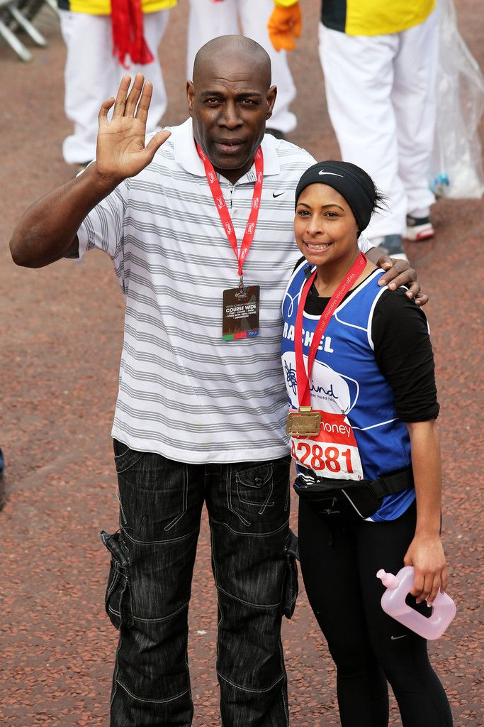 Former boxer Frank Bruno greets his daughter Rachel after she crosses the finish line during the Virgin London Marathon 2013 on April 21, 2013 in London, England.