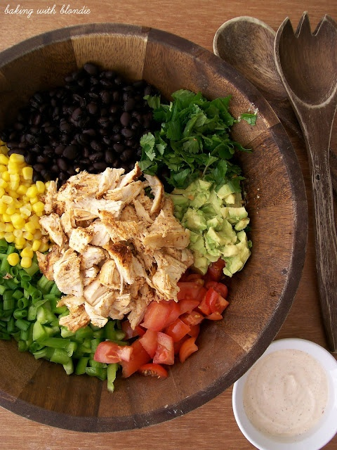 Southwest Chicken  Salad:   2 cups shredded chicken*  1/2 green bell pepper  1 can black beans  1 can sweet yellow corn, drained  2 plum tomatoes, diced  4 green onions, sliced  1 head romaine lettuce, cleaned and roughly chopped into bite-sized pieces  1/2 C cilantro, chopped  2 ripe avocados, diced  tortilla chips   Dressing:  1/2 C mayo  2/3 C plain Greek yogurt  1 T taco seasoning