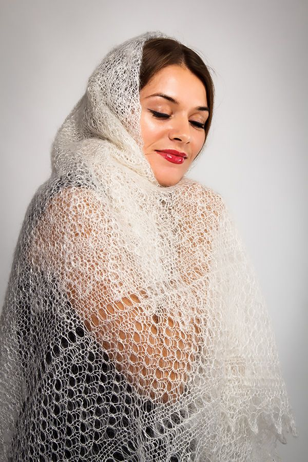 Russian Beauty Shawl is a shawl of the Classic Orenburg Woollen Shawls line. The shawl has a tender white colour, the canvas of the shawl is knitted with a small diamond pattern and decorated with a beautiful ornate fringe. Russian Beauty Shawl It is a wonderful gift for you and your loved ones. Give warmth to your significant other! 20% silk, 80% goat wool - 131$