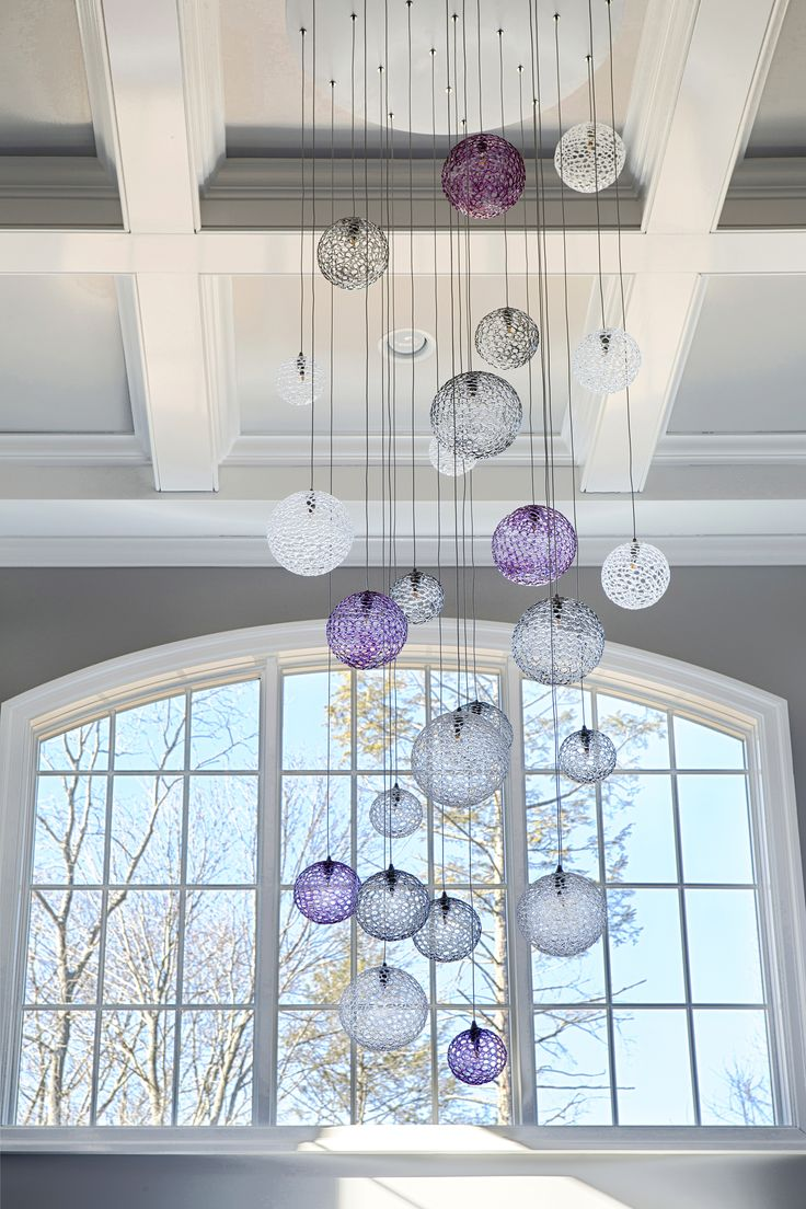 25 best two story chandeliers multi level chandeliers images on this multi colored hand blown chandelier adds sparkle and glamour in this foyer via cottages gardens arubaitofo Image collections