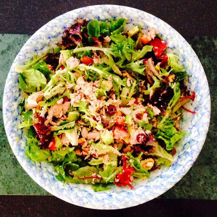 Tuna salad with sun-dried tomatoes, kalamata olives, lettuce, arugula, and avocado.