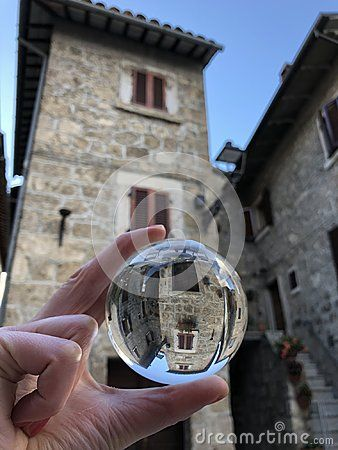 Glass ball view over stone houses in Castel Trosino, old medieval village, longobard origin, Marche region, Italy
