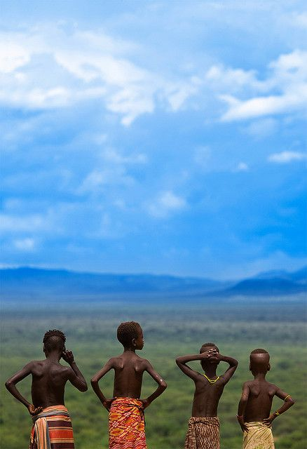 Karo Kids Ethiopia   ::   Watching the fantastic panorama they have in Korcho.   Next village: 20 kilometers from here, 2 hours driving in 4wheels!  Ethiopia  by Eric Lafforgue